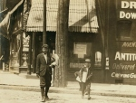 Truants selling papers at Jefferson and Washington 11 A.M. Monday, May 9th, 1910. Smallest boy is Marvin Adams, 2637 Washington Ave. Said he got his papers off'n de other feller. Location St. Louis, Missouri.