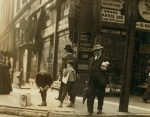 Young newsboy 6th and Pine Sts. May 10th, 1910. Location St. Louis, Missouri.